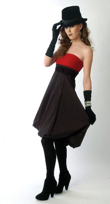 Christine models a red strapless dress with a black bubble hemline ($85, Marie Saint Pierre for Reitmans). She accessorizes with black opaque tights ($8.50, Secret), black suede booties ($112, Topshop), oxidized metal drop earrings ($12, Reitmans) and the writer's own vintage black fedora, gloves and bracelet. Christine wears an oxidized metal ring ($14, Reitmans), over the gloves for an extra dollop of style. (Sue Reeve/QMI AGENCY)