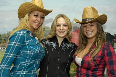Fans were invited to pose with the Edmonton Sun's CFR Sunshine Girls Friday at Canadian Finals Rodeo at Rexall Place in Edmonton, Alberta. IAN KUCERAK/EDMONTON SUN/QMI AGENCY