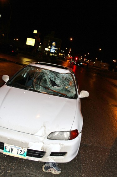 A pedestrian walked off a Keewatin Avenue boulevard  in front of the car around around 12 a.m.-1 a.m. Thursday, Nov. 24, 2011, according to a witness.  (COURTESY DAMAIN DEREK DONALD FRAZEE)