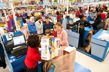 """Customers check out with their items at Toys """"R"""" Us in Pineville, North Carolina on November 25, 2011. (REUTERS/Chris Keane)"""