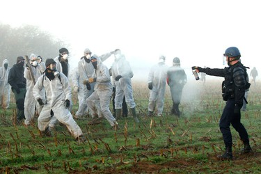 French CRS riot police clash with anti-nuclear demonstrators during a protest in Lieusaint near Valognes November 23, 2011 as protesters try to enter on the tracks before the departure of the train convoy of CASTOR containers which carry radioactive nuclear waste. (REUTERS/Benoit Tessier)