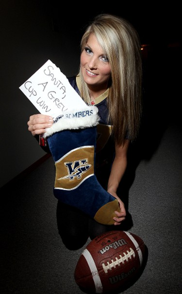 Miss Manitoba Crystal Oleschuk hopes for the early Christmas present of a Grey Cup. The Winnipeg Blue Bombers face the B.C. Lions in the CFL Grey Cup in Vancouver. JASON HALSTEAD/WINNIPEG SUN QMI AGENCY