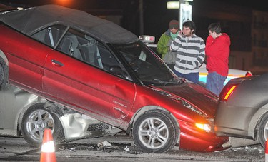 A motorist involved in this 5 car pileup on Macleod Trail and Glenmore Trail SW talks on the phone with a smile on his face in SW Calgary, Alberta on November 20, 2011. No one was injured in this incident. (STUART DRYDEN/QMI AGENCY)