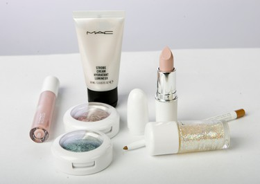 Shimmering highlighter cream ($18, Strobe Cream), two Baked Eye shadows ($25, each), Glitter and Ice Mineralize Eye Shadow, automatic eyeliner pen ($19), sheer shimmering nail lacquer ($23, Unconditionally Fabulous), pale silvered pink lipstick ($18.50) and sparkling silvered pink lip gloss ($45, all M.A.C. Cosmetics). (Derek Ruttan/QMI AGENCY)