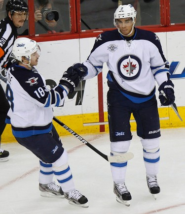 Winnipeg Jets' Bryan Little (L) congratulates teammate Evander Kane after Kane scored a first period goal against the Carolina Hurricanes during their NHL hockey game in Raleigh, North Carolina November 25, 2011. REUTERS/Ellen Ozier (UNITED STATES - Tags: SPORT ICE HOCKEY)