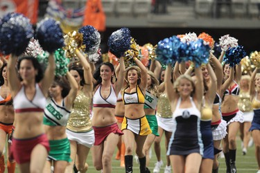 Cheerleaders storm the field prior to the CFL's 99th Grey Cup game at BC Place in Vancouver on Sunday November 27, 2011. the Winnipeg Blue Bombers and BC Lions face off. ANDRE FORGET/QMI AGENCY