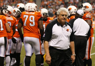 BC Lions Head Coach Wally Buono walks on the sideline after the first half of play against the Winnipeg Blue Bombers in the CFL's 99th Grey Cup football game in Vancouver, British Columbia, November 27, 2011.   REUTERS/Mark Blinch (CANADA  - Tags: SPORT FOOTBALL)