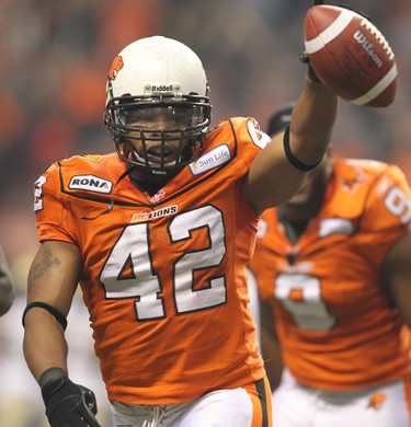 BC Lions linebacker Anton McKenzie (C) celebrates his interception of a Winnipeg Blue Bombers pass in the first half of the CFL's 99th Grey Cup football game in Vancouver, British Columbia, November 27, 2011.  AL CHAREST/CALGARY SUN/QMI AGENCY