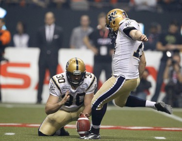 Winnipeg Blue Bombers kicker Justin Palardy kicks a field goal as Jamie Boreham holds during their game against the BC Lions in the second half of the CFL's 99th Grey Cup football game in Vancouver, British Columbia, November 27, 2011.  REUTERS/Mark Blinch (CANADA  - Tags: SPORT FOOTBALL)