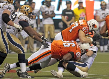 Winnipeg Blue Bombers' quarterback Buck Pierce is sacked during third quarter action at the CFL's 99th Grey Cup game at BC Place in Vancouver on Sunday November 27, 2011. ANDRE FORGET/QMI AGENCY