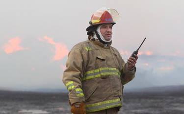 Enoch Fire Department Captain Mike Ward keeps surveys a fire at a wood recycling facility on the Enoch Cree Nation reserve continues to burn near Range Road 262 and 79 Avenue, just west of the Edmonton city limits, Friday Dec. 2, 2011. DAVID BLOOM EDMONTON SUN  QMI AGENCY