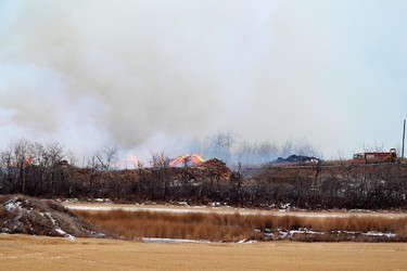 A fire at a wood recycling facility on the Enoch Cree Nation reserve continues to burn near Range Road 262 and 79 Avenue, just west of the Edmonton city limits, Friday Dec. 2, 2011. DAVID BLOOM EDMONTON SUN  QMI AGENCY