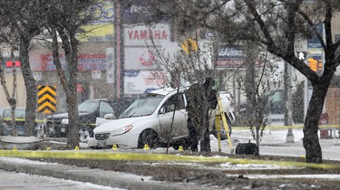 Police work at the scene of a serious motor vehicle accident near the intersection of Byng Place and Pembina Highway on the morning of Sat., Dec. 3, 2011. JASON HALSTEAD/WINNIPEG SUN QMI AGENCY