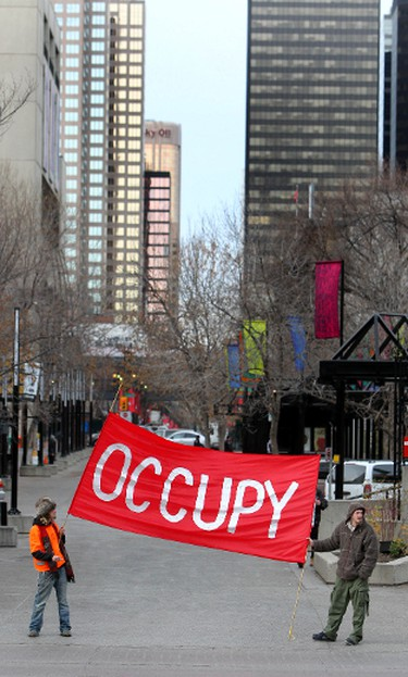 """Word/phrase: Occupy, elite, 1% and 99%. Meaning: The Occupy movement had protestors rebuffing the """"elite"""" and chanting """"We are the 99%"""" worldwide in 2011. """"Occupy"""" became so popular (it's GLM's """"Word of the Year""""), that the """"99%"""" who weren't living in tents (most of us) starting using it to express dissatisfaction with everyday affairs. ie. """"Occupy this sandwich."""" (Jim Wells/QMI AGENCY)"""
