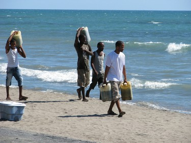Fishermen haul their gear after a day on the water off the coast of Alligator Pond, a fishing village in Jamaica. (Robin Robinson/QMI Agency)