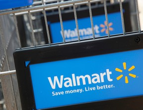 Shopping carts are seen outside a new Walmart Express store in Chicago in this July 26, 2011 file photograph.  (REUTERS/John Gress/Files)