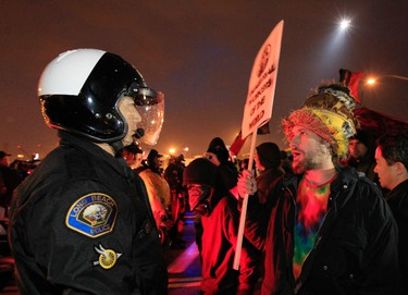 Protesters face riot police during the Occupy movements' attempt to shut down west coast ports in Long Beach, California December 12, 2011. REUTERS/Lucy Nicholson