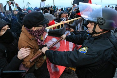 Police push back protesters during the Occupy movement's attempt to shut down West Coast ports, in Long Beach, California December 12, 2011. REUTERS/Lucy Nicholson