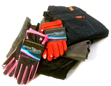 Black velvet pants ($189), Gold Textured Skinny Jeans ($225), Black skinny jeans ($169, all by 7 For All Mankind). Black and pink touch screen compatible gloves ($36) and a pair of red touch screen compatible gloves ($42, both by Isotoner). (Mike Hensen/QMI AGENCY)