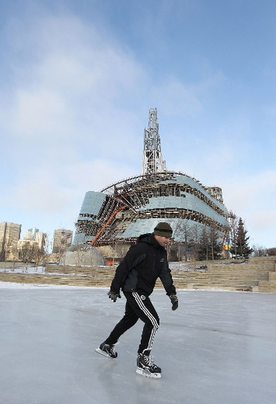 Adam Kyraly, a resident of Budapest, Hungary, skates at The Forks in front of the under-construction Canadian Museum for Human Rights on Thurs., Dec. 15, 2011. Kyraly is visiting relatives in Winnipeg. Officials from The Forks announced Thursday that 1.2 kilometres of trails within Arctic Glacier Winter Park and on the two skating rinks are now open and being groomed daily. Other features including the snowboard park, toboggan run and snowman lane are still being prepared. JASON HALSTEAD/WINNIPEG SUN QMI AGENCY Stand alone photo