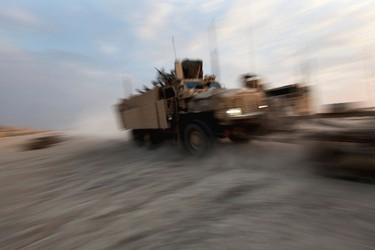 A Mine Resistant Ambush Protected (MRAP) vehicle drives through the nearly deserted Camp Adder, now known as Imam Ali Base, near Nasiriyah December 16, 2011. The last convoy of U.S. soldiers pulled out of Iraq on Sunday, ending nearly nine years of war that cost almost 4,500 American and tens of thousands of Iraqi lives. (REUTERS)