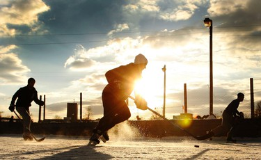 Hockey often makes for great photos, and this was no exception. The sun sets on a game of outdoor hockey at Brewer Park on Feb. 11, the day before CBC's annual Hockey Day in Canada. (Darren Brown/Ottawa Sun)
