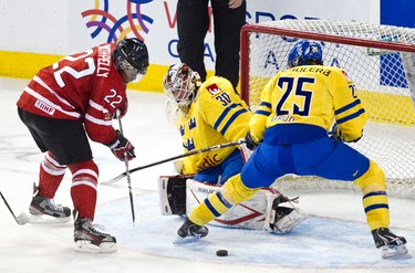 Canada's Devante Smith-Pelly can't get past Sweden's Johan Gustafsson during the third period of the Canada vs. Sweden IIHF World Junior Championship exhibition game at Rexall Place in Edmonton on {year}, December 23, 2011. CODIE MCLACHLAN/EDMONTON SUN QMI AGENCY
