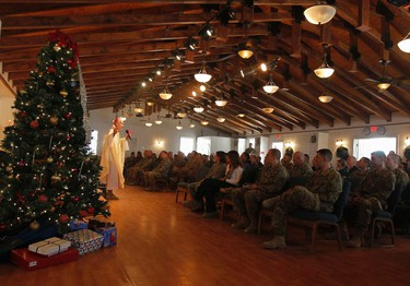 U.S. troops attend during Christmas celebrations at Bagram air field, north of Kabul Dec. 25, 2011.  REUTERS/Omar Sobhani