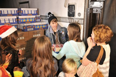 Justin Bieber spent his day giving back in the Toronto area, including a stop at The Daily Bread Food Bank  in Toronto Wednesday, Dec. 21. (MuchMusic/George Pimentel for WireImage)