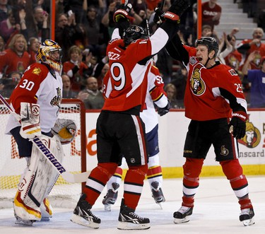 Ottawa Senator Chris Neil celebrates his goal with Jason Spezza in front of Florida Panther netminder Scott Clemmensen during first period NHL hockey action at  Scotiabank Place. Friday December 22,2011. (ERROL MCGIHON/THE OTTAWA SUN/QMI AGENCY).