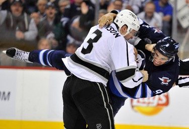 Winnipeg Jets' Evander Kane (R) fights Los Angeles Kings' Jack Johnson during the second period of their NHL hockey game in Winnipeg December 29, 2011. REUTERS/Fred Greenslade (CANADA - Tags: SPORT ICE HOCKEY TPX IMAGES OF THE DAY)