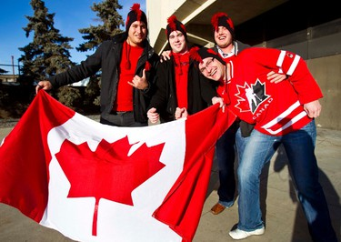 (From left) Andrew Bardesteani, Lucas Herklotz, Anthony Bachert and Mike Nelson mug for the camera prior to the opening game of the IIHF world junior championship at Rexall Place in Edmonton on December 26, 2011. CODIE MCLACHLAN/EDMONTON SUN QMI AGENCY