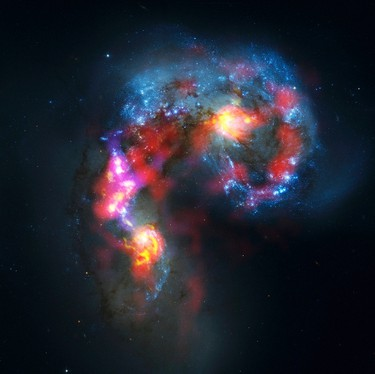 The Antennae Galaxies (also known as NGC 4038 and 4039) are seen in this image made from the parabolic antennas of the ALMA (Atacama Large Millimetre/Submillimetre Array) project at the El Llano de Chajnantor in the Atacama desert, some 1,730 km north of Santiago and 5,000 metres above sea level, October 3, 2011. (ALMA (ESO/NAOJ/NRAO)Visible light image: the NASA/ESA Hubble Space Telescope)