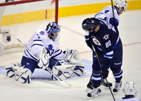 Toronto Maple Leafs goaltender James Reimer makes a save on Winnipeg Jets' Nik Antropov (80) during the first period of their NHL hockey game in Winnipeg December 31, 2011. (FRED GREENSLADE/Reuters)