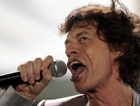 "Mick Jagger of the Rolling Stones performs during the Rolling Stones' ""A Bigger Bang"" free concert on Copacabana Beach in Rio de Janeiro February 18, 2006. (REUTERS/Sergio Moraes)"