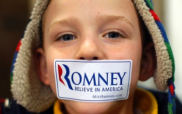 A boy wears a campaign sticker over his mouth before a rally with Republican presidential candidate and former Massachusetts Governor Mitt Romney in Dubuque, Iowa January 2, 2012, ahead of the Iowa Caucus on January 3, 2012.   REUTERS/Brian Snyder