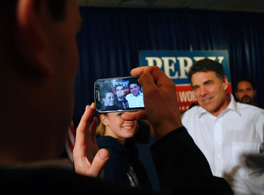 U.S. Republican presidential candidate and Texas Governor Rick Perry has his photo taken during a campaign stop in Carroll, Iowa January 2, 2012.REUTERS/Joshua Lott