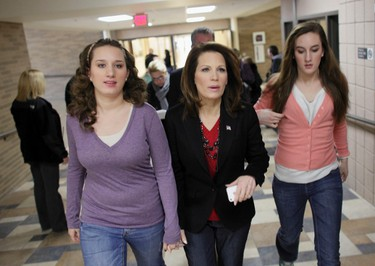 """Republican presidential candidate and Representative Michele Bachmann (C) arrives with her daughters Elisa Bachmann (L) and Caroline Bachmann (R) to campaign at the """"Rock the Caucus"""" Rally at Valley High School in West Des Moines, Iowa, January 3, 2012. REUTERS/John Gress"""