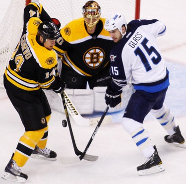 Boston Bruins defenseman Joe Corvo (L) battles Winnipeg Jets left wing Tanner Glass (R) in first period action during their NHL hockey game in Boston, Massachusetts January 10, 2012.    REUTERS/Dominick Reuter  (UNITED STATES - Tags: SPORT ICE HOCKEY)