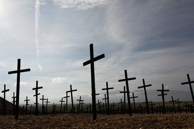 Crucifixes are seen at a mass grave site at Titanyen, on the outskirts of Port-au-Prince January 11, 2011. Despite billions of dollars pledged by donors to help Haiti rebuild, two years later, reconstruction efforts remain painstakingly slow.  REUTERS/Jorge Silva