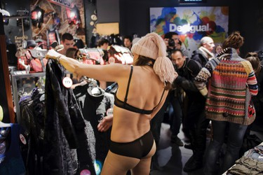 People in their underwear arrive at the Lyon's Desigual store, to be given  free clothes as part of the Spanish company winter sale offer, on January 11, 2012. AFP PHOTO JEAN-PHILIPPE kSIAZEK
