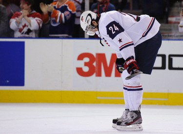 Team USA's Jarred Tinordi reacts after being defeated by the Czech Republic during their 2012 IIHF U20 World Junior Hockey Championship in Edmonton, Alberta, Dec. 30, 2011.  (REUTERS/Todd Korol)
