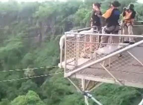 """An Australian woman says it's """"a miracle"""" she's alive after her bungee cord snapped and she was sent hurtling 111 metres into a crocodile-infested river in Africa."""