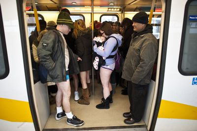 A group of people disrobed to take part in the annual The No Pants Skytrain Ride in Vancouver, British Columbia on Jan. 8. The No Pants Skytrain (subway) Ride is global event to designed to make people giggle. (CARMINE MARINELLI/QMI AGENCY)