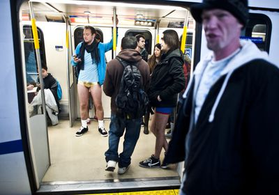 A man looks over at a group of people who disrobed to take part in the annual The No Pants Skytrain Ride in Vancouver, British Columbia, on Jan. 8. The No Pants Skytrain (subway) Ride is global event to designed to make people giggle. (CARMINE MARINELLI/QMI AGENCY)