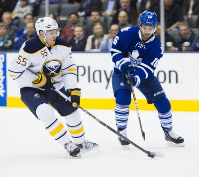 Clarke MacArthur and Sabres' Jochen Hecht go for the puck in the second. (Ernest Doroszuk/TORONTO SUN)