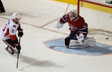 Ottawa Senators' Daniel Alfredsson (11) scores the winning goal against Montreal Canadiens' goalie Carey Price during NHL hockey overtime shootout action in Montreal January 14, 2012.  REUTERS/Christinne Muschi (CANADA - Tags: SPORT ICE HOCKEY)