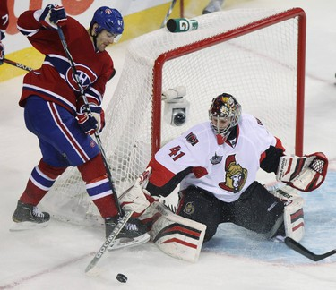 Ottawa Senators' goalie Craig Anderson (41) makes a save against Montreal Canadiens Max Pacioretty (67) during third period NHL hockey action in Montreal, January 14, 2012. REUTERS/Christinne Muschi (CANADA - Tags: SPORT ICE HOCKEY)