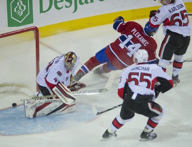 Tomas Plekanec scores as the Senators take on the Canadiens in Montreal, January 14, 2012. PIERRE-PAUL POULIN/QMI AGENCY