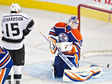 Edmonton Oilers Devan Dubnyk lets in a Los Angeles Kings goal as Brad Richardson looks on during third period NHL action at Rexall Place in Edmonton, Alberta on Sunday, January 15, 2012. The Oilers won 2-1 in overtime. AMBER BRACKEN/EDMONTON SUN/QMI AGENCY